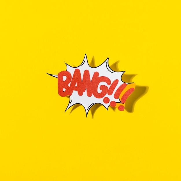Bolha do discurso em quadrinhos retrô elegante com estrondo de texto em fundo amarelo Foto gratuita