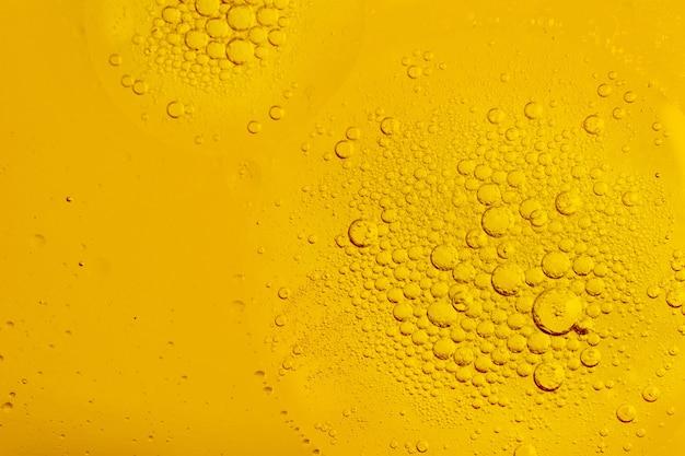 Bolhas de óleo ou soro de fundo Foto Premium