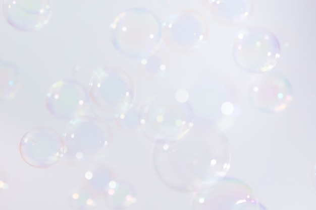 Bolhas de sabão flutuam fundo. Foto Premium