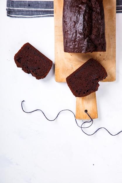 Bolo, cupcake com bananas e chocolate Foto Premium