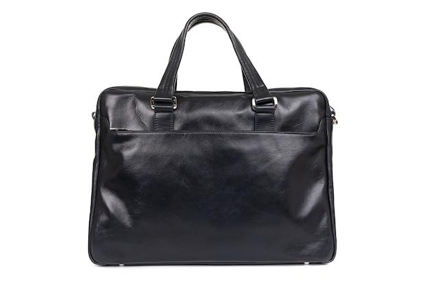 Bolsa feita de couro genuíno em uma superfície branca Foto Premium
