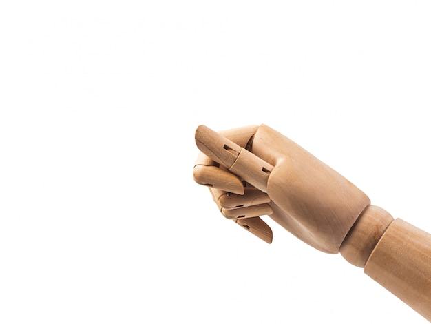 Boneca de madeira da mão no fundo branco Foto Premium