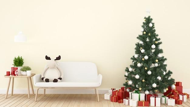 Boneca rena, árvore de natal e presente na sala de estar Foto Premium
