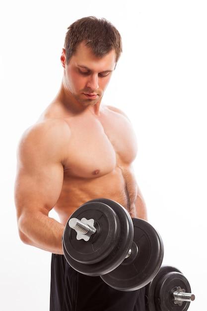 Bonitão muscular malhando Foto gratuita