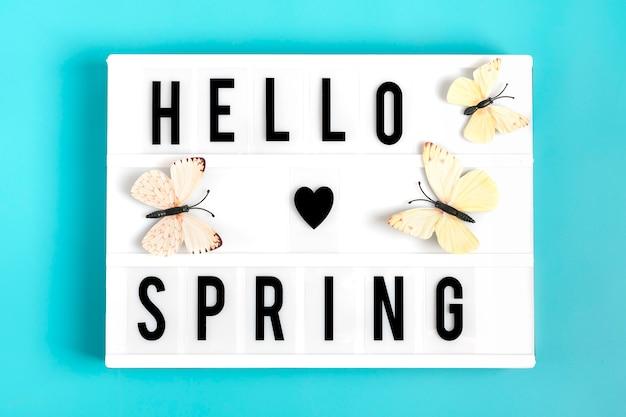 Borboleta, lightbox, com, citação, olá, primavera, ligado, experiência azul, apartamento, leigo Foto Premium
