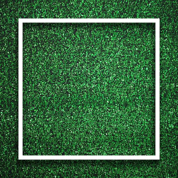 Borda branca quadrada do quadro do retângulo na grama verde com fundo da sombra. conceito de elemento de fundo de decoração. Foto Premium
