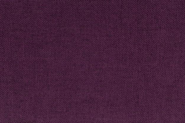 Borgonha escura, roxa de um material têxtil. tecido com textura natural. pano de fundo. Foto Premium