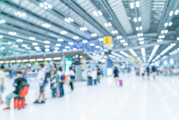 Borrão abstrata e interior terminal do aeroporto desfocado Foto Premium