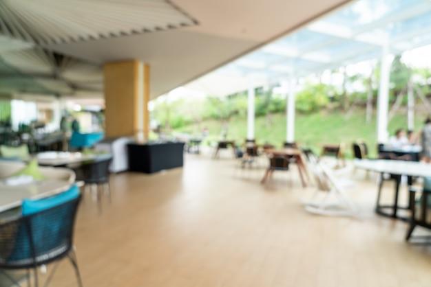 Borrão abstrato e buffet de café da manhã desfocado no interior do restaurante do hotel como fundo desfocado Foto Premium