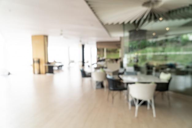 Borrão abstrato e buffet de café da manhã desfocado no interior do restaurante do hotel Foto Premium