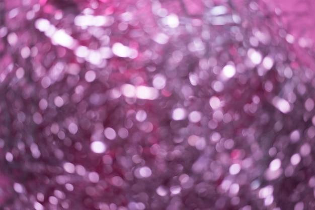 Borrão de enfeites de natal. resumo borrado de fundo rosa e prata luzes Foto Premium