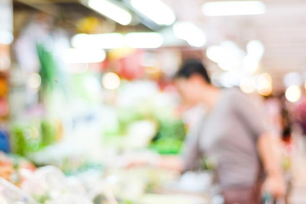 Borrão de mercado e pessoas com luz de bokeh Foto Premium
