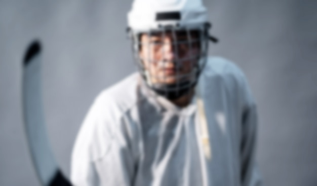 Borrão foto professional jogador de hóquei no gelo. Foto Premium