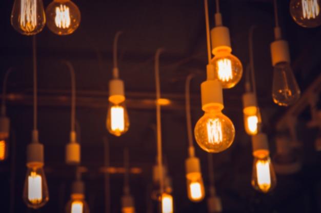 Borrão pendurar luz blub interior café iluminação Foto Premium