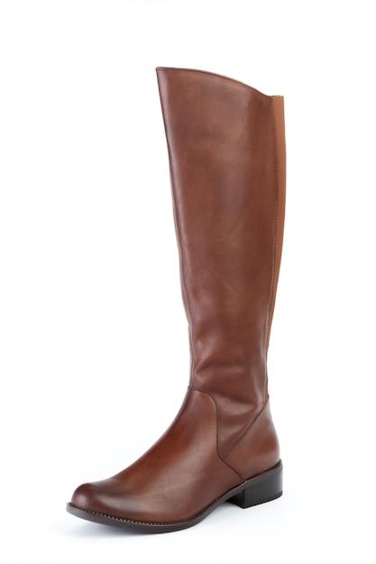 Botas de couro de joelho alto de mulher isoladas no branco Foto Premium