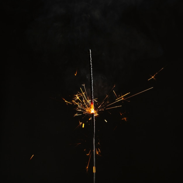 Bright sparkler on dark background Foto gratuita