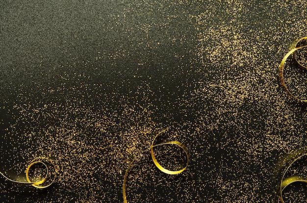 Brilhos dourados e fitas em preto Foto Premium