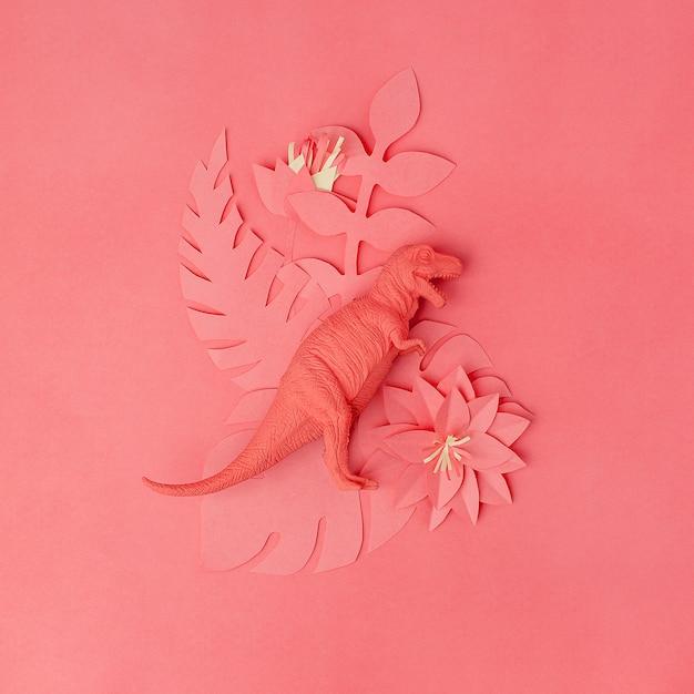 Brinquedo de dinossauro tiranossauro e flores de papercraft de origami Foto Premium