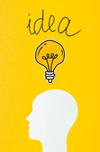 Cabeça branca e conceito de idéia de lâmpadas Foto gratuita