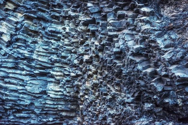 Cabo dyrholaey islândia de reynisfyal das montanhas da textura. mundo da beleza Foto Premium