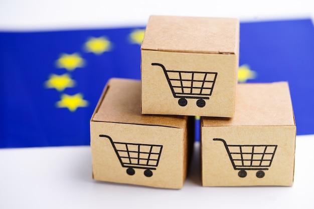 Caixa com logotipo de carrinho de compras e a bandeira da união europeia (ue) Foto Premium