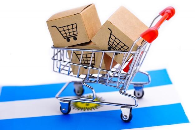 Caixa com logotipo de carrinho de compras na bandeira da argentina Foto Premium