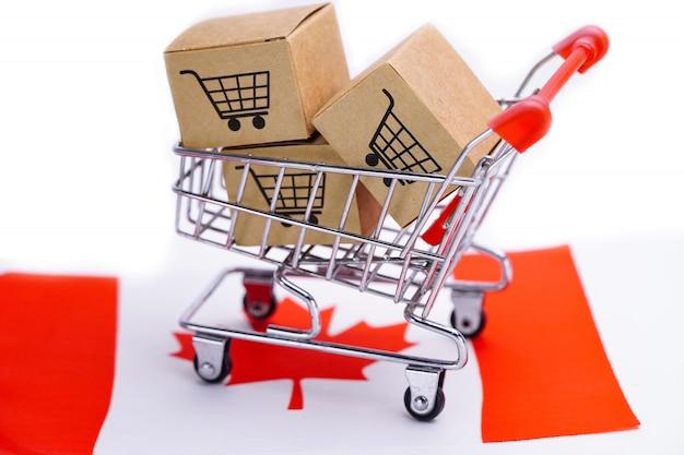 Caixa com logotipo de carrinho de compras na bandeira do canadá Foto Premium