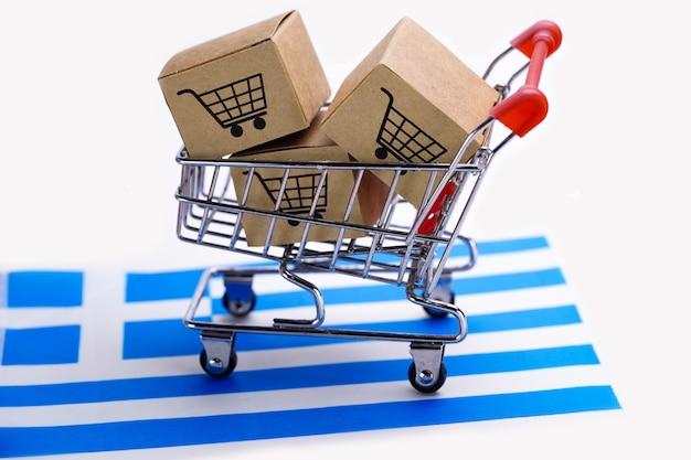 Caixa com o logotipo do carrinho de compras e a bandeira da grécia. Foto Premium