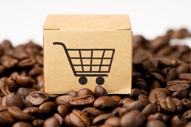Caixa com o símbolo do logotipo do carrinho de compras em grãos de café. Foto Premium
