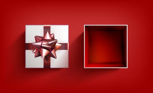 Caixa de presente surpresa. fita de vetor presente. ilustração de comemoração de aniversário com laço vermelho. Foto Premium