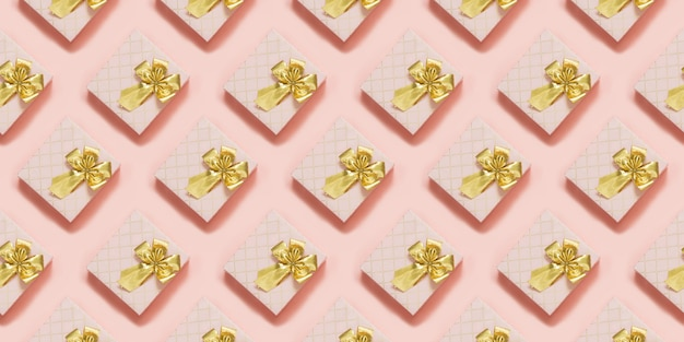 Caixas de presente rosa com fita dourada na superfície rosa pastel. vista do topo. padrão sem emenda. Foto Premium