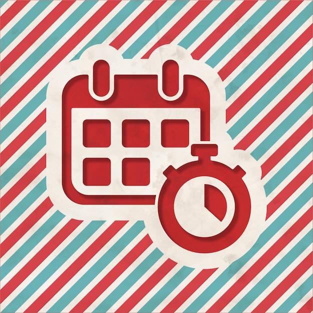 Calendário com cronômetro em fundo listrado de vermelho e azul. conceito vintage em design plano. Foto Premium
