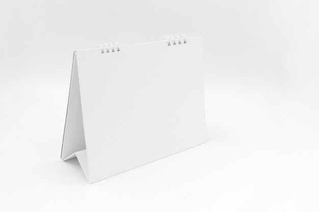 Calendário de mesa em fundo branco Foto Premium