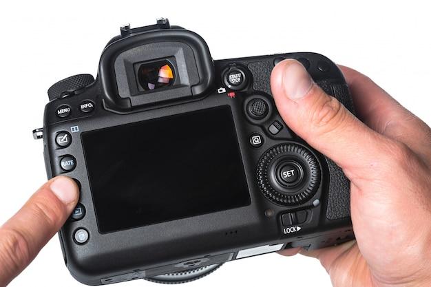 Câmara fotográfica na mão isolada no branco Foto Premium