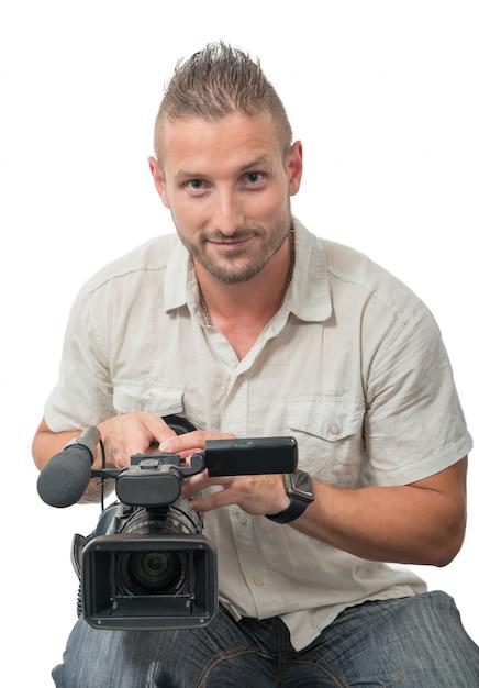 Cameraman com filmadora profissional em branco Foto Premium