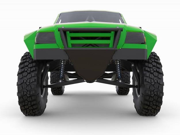 Caminhão de corrida verde mais preparado para o terreno desértico Foto Premium