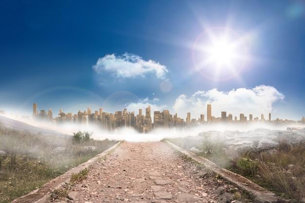 Caminho pedregoso que conduz à grande expansão urbana sob o sol Foto Premium