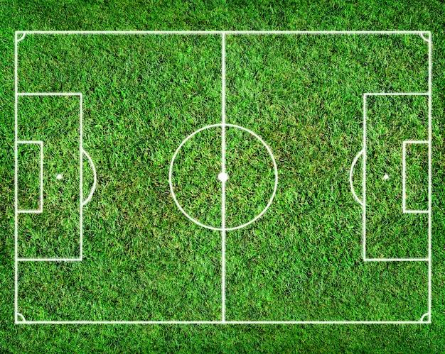 Campo de futebol com grama como pano de fundo Foto Premium