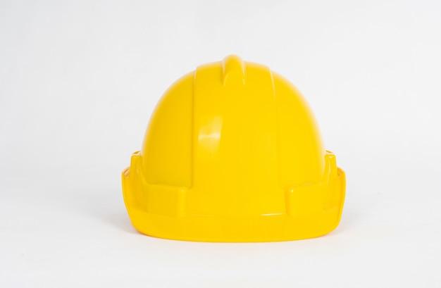 Capacete de construção amarelo isolado no branco Foto Premium