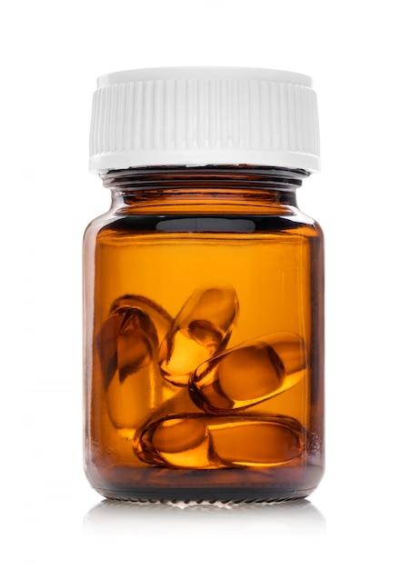 Cápsulas de óleo de peixe em frasco de vidro castanho Foto Premium