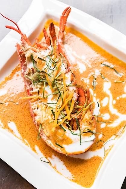 Caril vermelho de lagosta Foto Premium