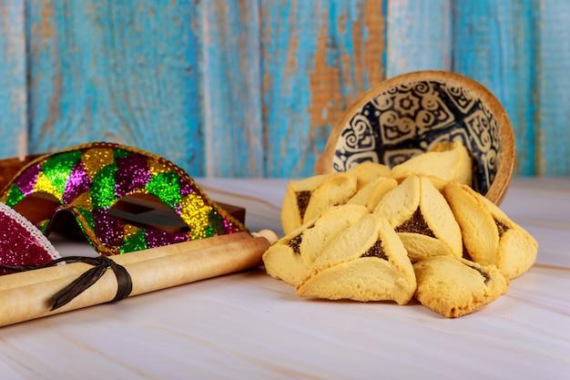 Carnaval com barulho hamantaschen cookies purim feriado judaico Foto Premium