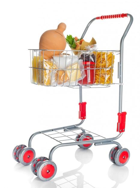 Carrinho de compras cheio com caixa de dinheiro e produtos alimentares Foto Premium