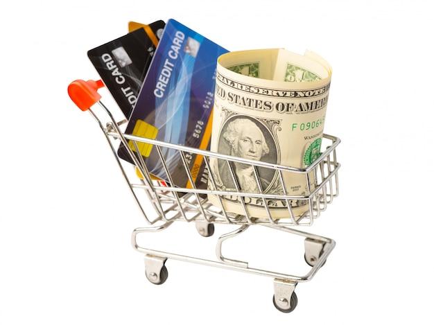 Cartão de crédito e cédulas do dólar americano no carrinho de compras em branco. Foto Premium