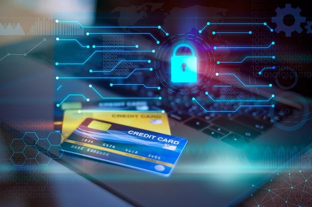 Cartão de crédito no computador com cadeado digital e tecnologia ícones, conceito de segurança do cartão de crédito Foto Premium