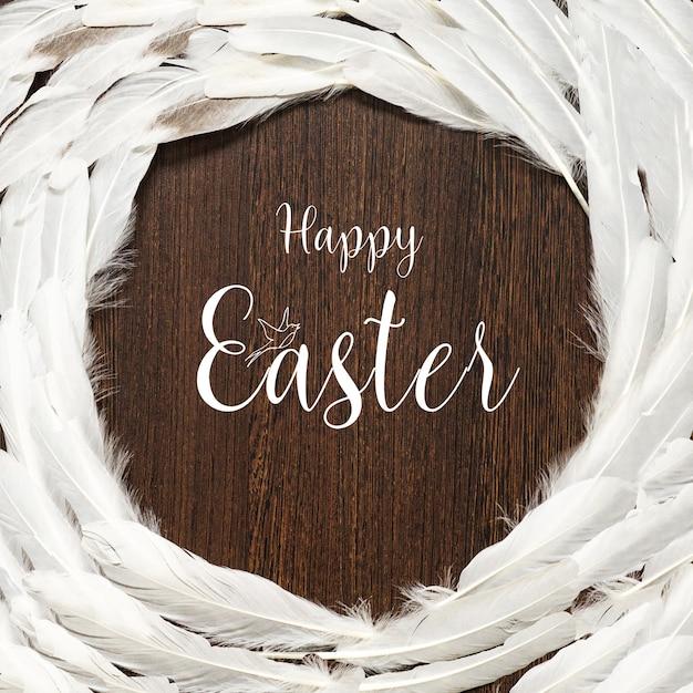 Cartão de feliz páscoa. muitas penas brancas em um fundo de madeira. feliz páscoa. Foto Premium