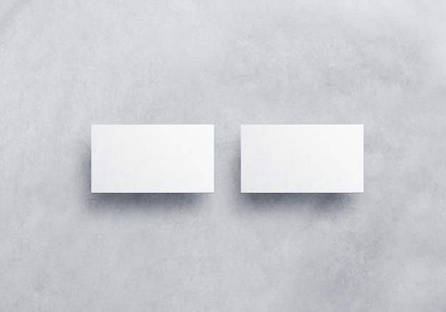 Cartão de visita em branco branco isolado no plano de fundo texturizado cinza Foto Premium