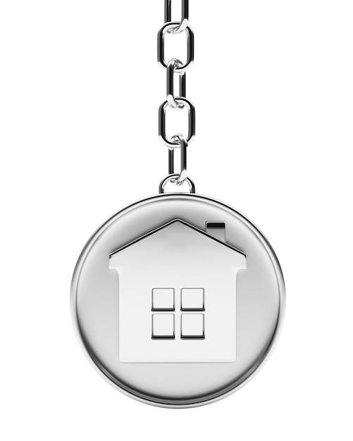 Casa em chaveiro redondo de prata Foto Premium