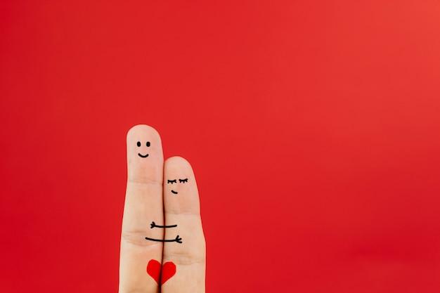 Casal de arte dedo abraçando suavemente Foto gratuita