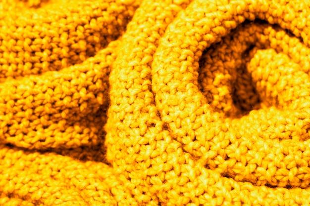 Ceilão na moda cor amarela de lã de malha tecido close-up, textura, plano de fundo Foto Premium